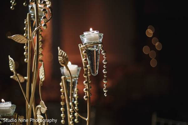 Elegant Indian wedding table candles decor.