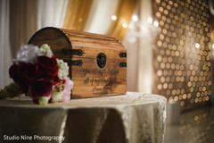 Personalized Indian wedding stage trunk decor.