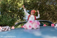 Indian groom celebrating during the baraat