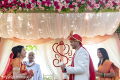 Indian bride meeting with Raja at the aisle