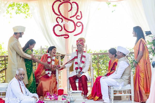 Joyful couple with guests