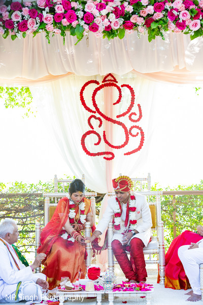 Indian couple under the venue decor