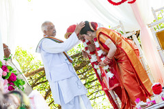 Maharani and Indian groom being blessed