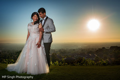 Amazing shot of Indian couple by the sunset