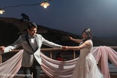 Indian bride and groom enjoying the dancing