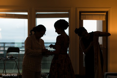 Indian bride getting ready silhouette capture.