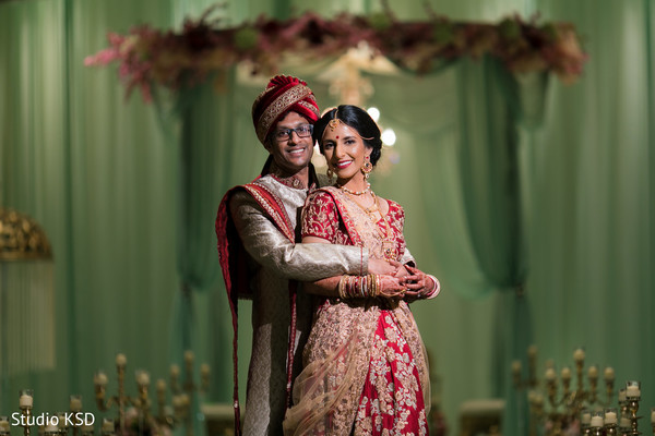 See this lovely Indian couple posing at their mandap .