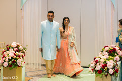 Marvelous entrance to ceremony of Indian bridesmaid and groomsmen.