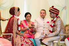 Indian bride and groom with ceremony lasso ritual.