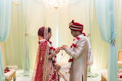 Indian groom putting ring to bride capture.