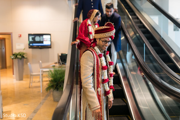 Indian groom and bride walking out of ceremony capture.