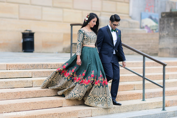 Enchanting Indian couple walking out doors.