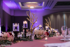 Elegant Indian wedding table flowers decorations.