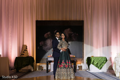 Dazzling Indian bride and groom at reception.