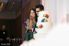 Maharani taking a cake bite.