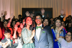Indian bride and groom amazed at reception party.