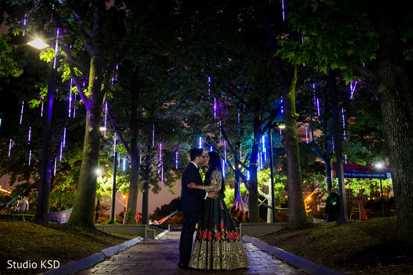 Incredible Indian couple outdoors at reception.