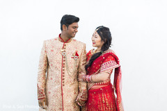 Beautiful fusion indian couple posing for the camera