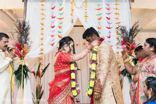 Indian groom receiving his garland