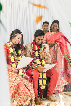 Sweet indian groom reciting his vows