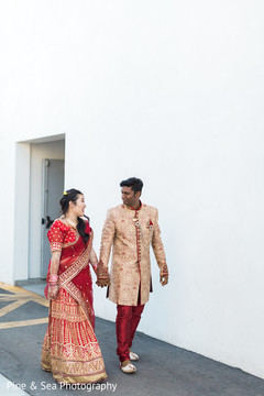 Indian couple walking holding hands