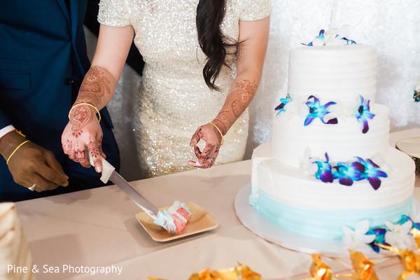 Beautiful indian wedding cake cutting scene