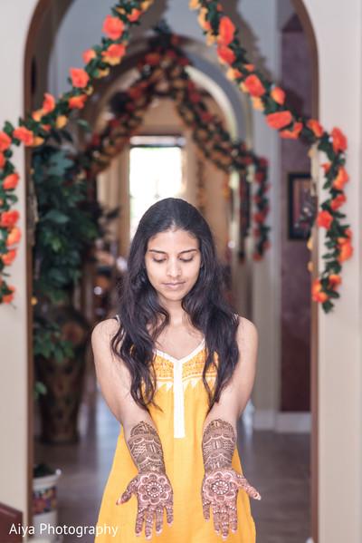 Indian bride showing her henna art.