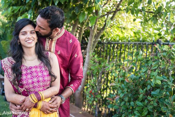 Ravishing Indian couple's wedding sangeet attire