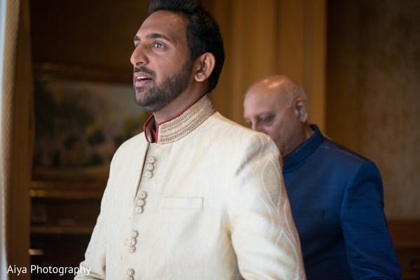 Indian groom getting ready scene.