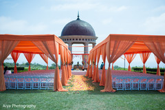 Elegant outdoors Indian wedding ceremony decor.