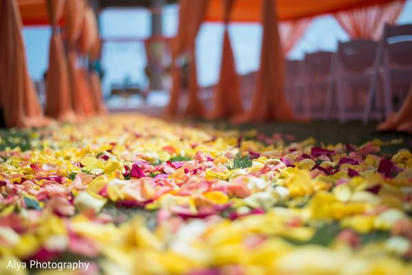 Closeup capture of Indian wedding ceremony aisle decor.