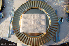 Golden plate for Indian wedding reception table.