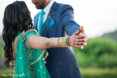Hand by hand Indian couple's closeup capture.