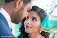 Enchanting Indian bride looking at groom.