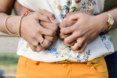 Adorable Indian couple holding hands capture.