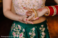 Indian bride putting her choora on.