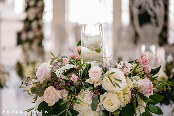 Dazzling Indian wedding ceremony roses decor.