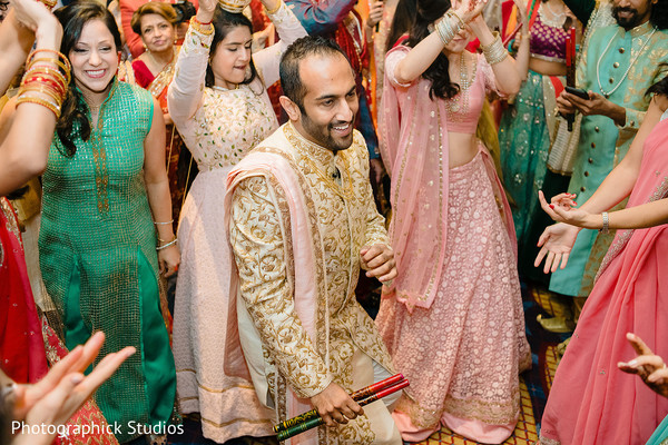 See this charming Indian groom at Garba dance.