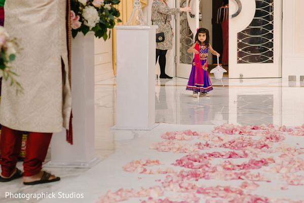 Lovely Indian flower girl entrance.