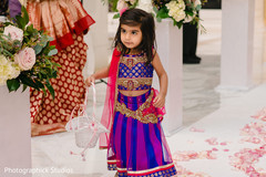 Pretty Indian flower girl at ceremony.