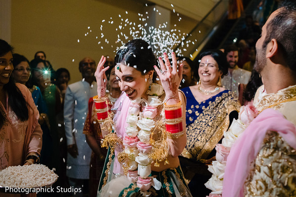 Indian bride throws rice behind her.