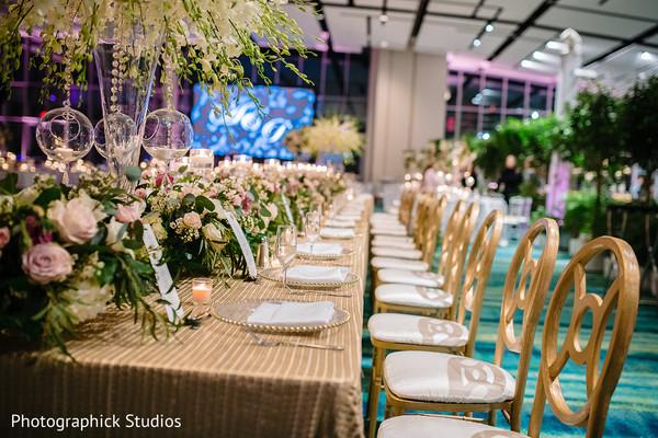Elegant indian wedding table flowers decor.