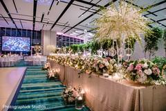 Unique Indian wedding reception table flowers decoration.