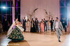Upbeat indian couple's dance capture.