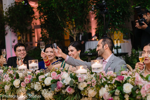 Cheerful Indian couple at reception capture.