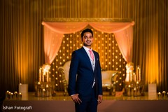 Gorgeous indian groom in reception outfit.