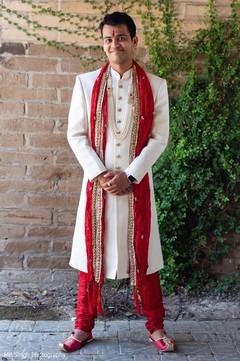 Indian groom posing with sherwani
