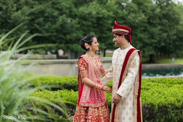 Indian bride and groom outdoors taking pictures