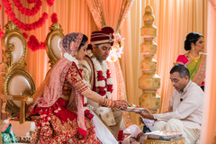 Indian bride and groom during rituals