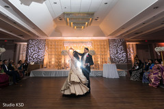 Indian bride and groom having a dance